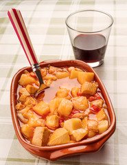 potato stew with cod and glass of wine