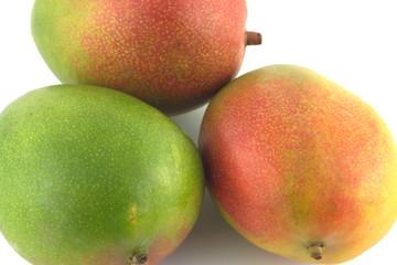 Three ripe appetizing tropical fruit mango isolated closeup