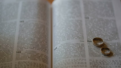 Closeup of Holy bible Russian language with wedding rings