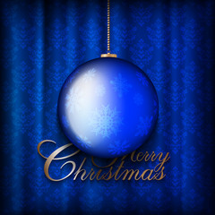 Christmas bauble on patterned background