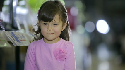Portrait of female child at store who smiles
