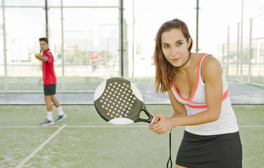Woman in court ready for play paddle tennis
