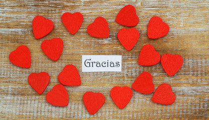 Gracias (thank you in Spanish) with little red wooden hearts