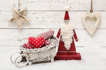 Santa Claus and christmas decoration on wooden background in sca