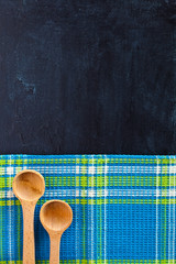 wooden spoons and tablecloth