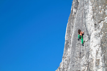 Young boy rock climber