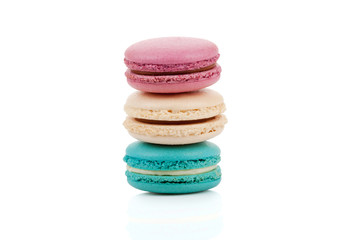 Three multicolored stacked macaroons isolated