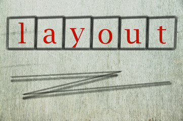 layout writen on a wall background