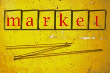 market writen on a wall background
