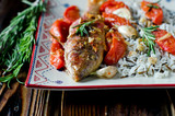Red mullet baked with tomato, garlic and rosemary with a garnish
