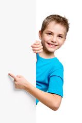 Portrait of happy little boy with white blank