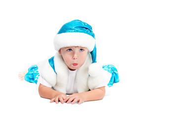 Surprised boy in Santa suit lying