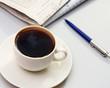 Cup of coffee near press.