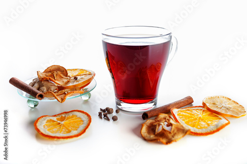 Fotobehang Thee mulled wine with spices, ginger, cinnamon on a white background