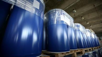 New blue barrels inside a storage warehouse slider shot