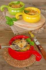 Julienne with chicken and mushrooms under a cheese crust