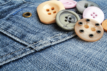 Colored buttons on denim