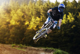 Mountainbiker jump in autumn forest