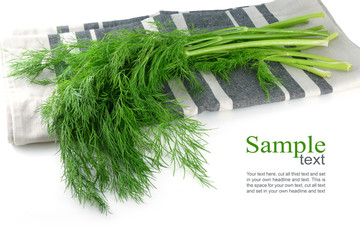 bunch of dill on a  kitchen towel, isolated, corner background,
