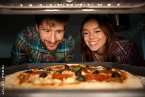 Leinwandbild Motiv Delicious pizza at oven
