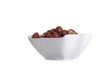 hazelnuts in white dish