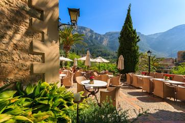 Local restaurant terrace in Deia village, Majorca island, Spain