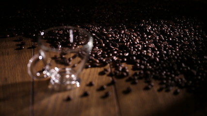 black coffee with fresh roasted coffee beans background