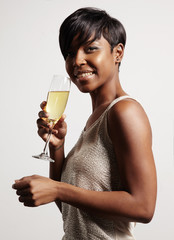portrait of a celebrating woman, holding a glass of champagne