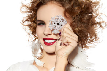 Beautiful girl with evening makeup smile take cristal snowflake