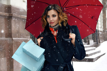 Beautiful woman snow street buy presents Christmas New Year .