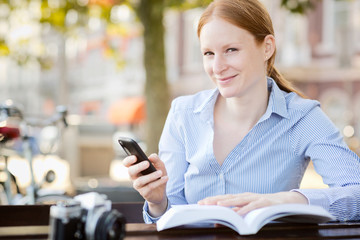 Woman with Smartphone and Book