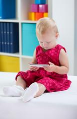 Little cute girl using phone