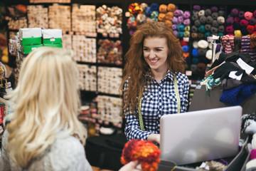 Two young women in knitting shop