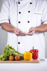 Chef holds onion