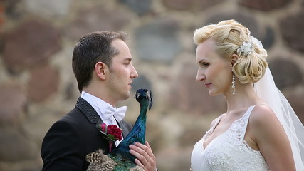 newlyweds photographed with peacock sunbird close up