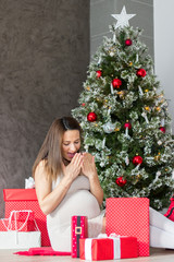 Pregnant woman surprised with gifts for Christmas