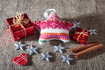 Christmas decorations, candles, gifts on linen background