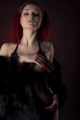 Beautiful sexy woman with red hair and long nails