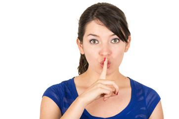 beautiful young woman gesturing silence shhh with finger on