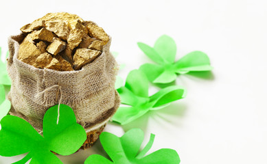 green clover leaves and  bag of gold - St. Patrick's Day