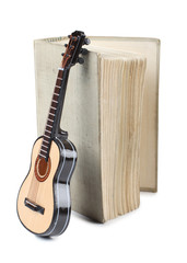 Old book and guitar