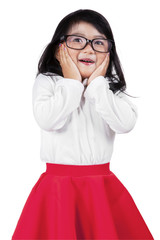 Excited little girl with glasses in studio
