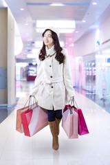 Full length of shopping girl at mall