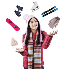 Girl juggling the equipment of winter holiday