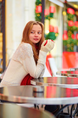 Girl in a Parisian cafe at Christmas time