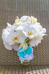 beautiful wedding bouquet from white orchids on natural backgrou