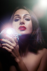 woman playing with mirror ball