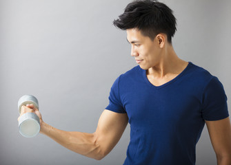 strong and young man with dumbbell
