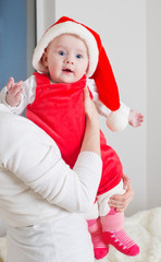mother and baby in red Christmas hat