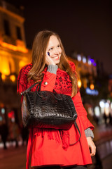 Beautifull girl with bag stay at square in the night